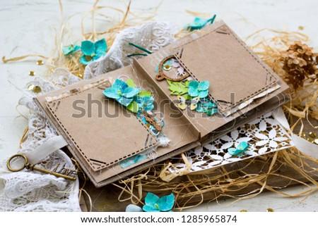 Spring wedding scrapbooking album in rustic style with handmade hydrangea flowers