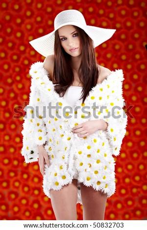 Spring woman dressed flower coat posing  on flowers background