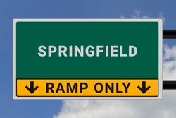 Springfield logo. Springfield lettering on a road sign. Signpost at entrance to Springfield, USA. Green pointer in American style. Road sign in the United States of America. Sky in background