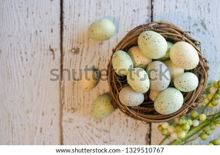 Springtime composition.  Horizontal flat lay with overhead view.  Bird nest with speckled eggs with copy space for text. #1329510767