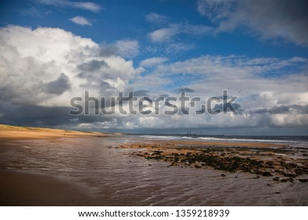 Springtime sunshine and showers in one picture. The beach between Blyth and Seaton Sluice in Northumberland on the North East Coast of England