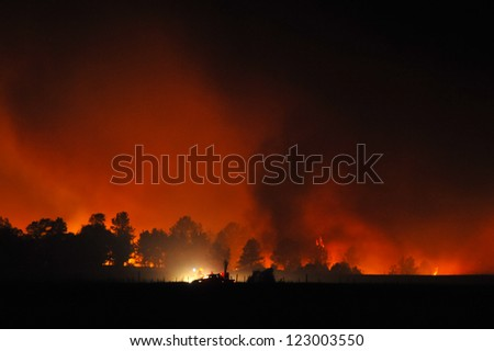 SPRINGVIEW, NE - JULY 24: Firefighters battle the Fairfield Creek Fire early Tuesday July 24, 2012 near Springview, Ne. High winds and dry conditions have fueled the blaze which destroyed 17 homes.