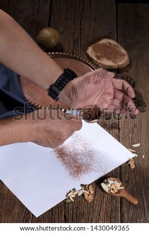 Sprinkle chocolate powder on paper.