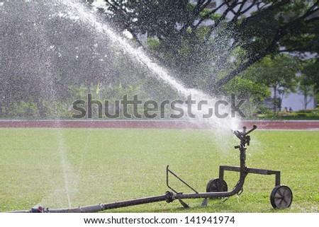 sprinkler head watering the grass