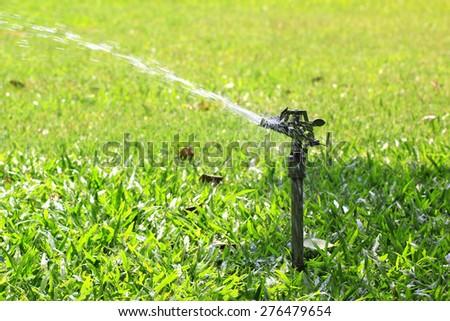 sprinkler watering grass #276479654