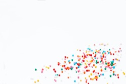 sprinkles on a white background. Festive background for Valentine's day, birthday, holiday, party