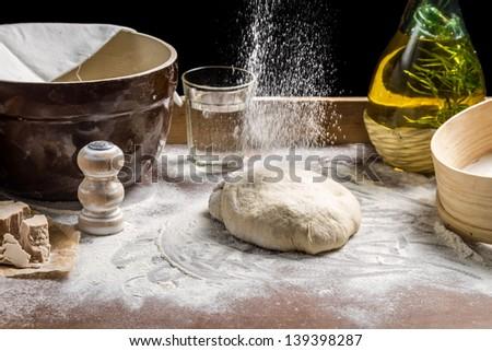 Sprinkling flour pizza dough