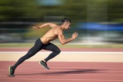Sprinter leaving  on the running track. Explosive start.