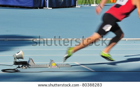 Sprinter leaving the blocks - stock photo