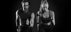 Sprinter run. Strong athletic woman and man running on black background wearing in the sportswear. Fitness and sport motivation. Runner concept.