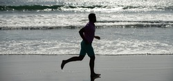 sprinter silhouette. endurance and stamina. sport athlete run fast to win in the ocean.