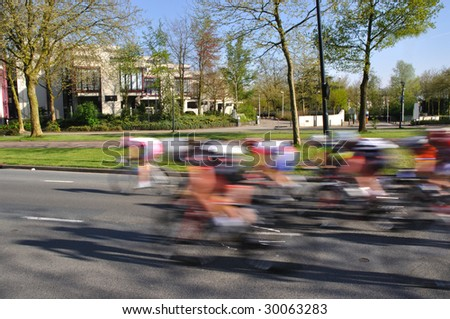 Sprinting bikers at the end of a tour