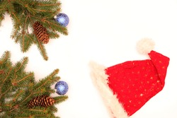 Spruce branches, santaclaus hat  as a background for Christmas and New Year. The background is white.