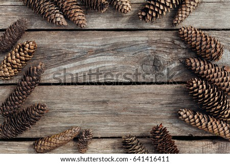 Spruce cones lie on a wooden texture background with copy space  #641416411