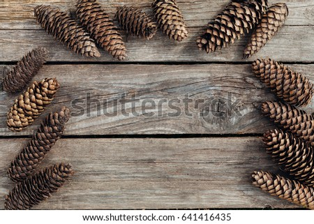 Spruce cones lie on a wooden texture background with copy space  #641416435