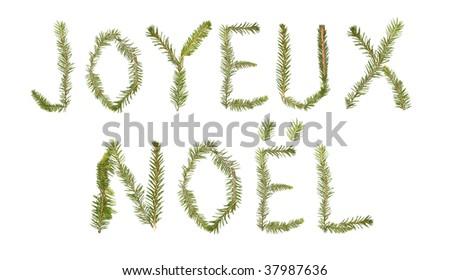 Spruce twigs forming the phrase 'Joyeux Noel'' isolated on white