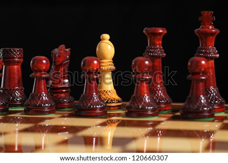 Spy bishop on the chessboard with a black background