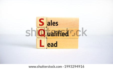 SQL sales qualified lead symbol. Wooden blocks with words 'SQL sales qualified lead'. Beautiful white background. Business and SQL sales qualified lead concept. Copy space.