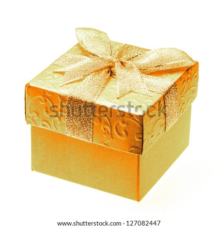 Square box decorated with golden paper and ribbon