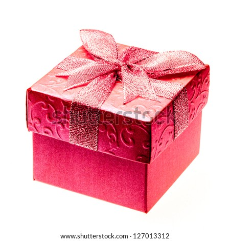 Square box decorated with red paper and ribbon
