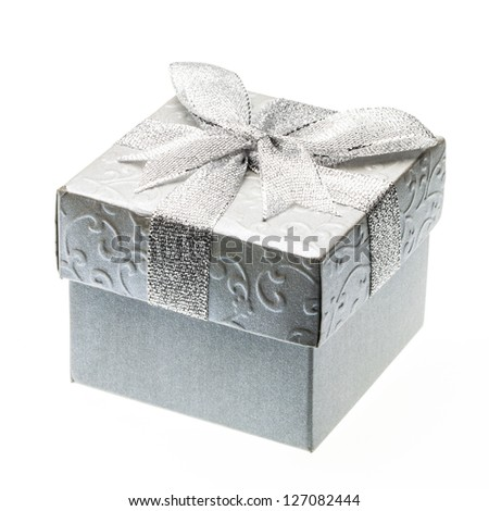 Square box decorated with silver paper and ribbon