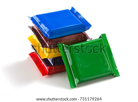 Square chocolate bars in multi-colored packaging on a white isolated background #731179264