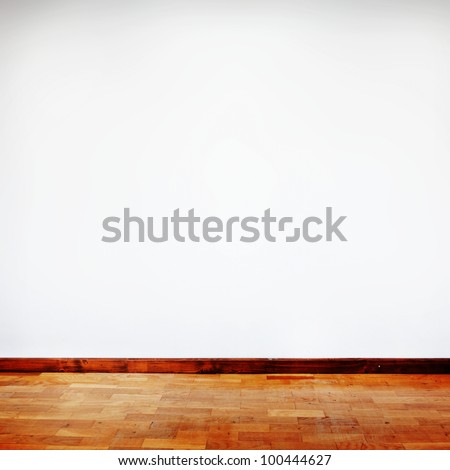 square composition of empty room with white wall and wooden flor