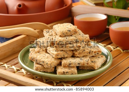 Square cookies on the green plate