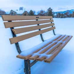 Square crop Picturesque snow covered landscape in winter with empty bench by the Utah Lake
