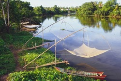 Square dip net for catching the fish as the traditional fishery in Asia, it was hung beside the canal with the small boat, Fish Trap
