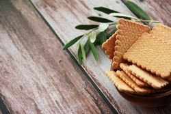 square dry sweet cookies with decorative ornaments