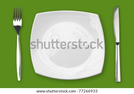 square empty plate fork and knife on green table