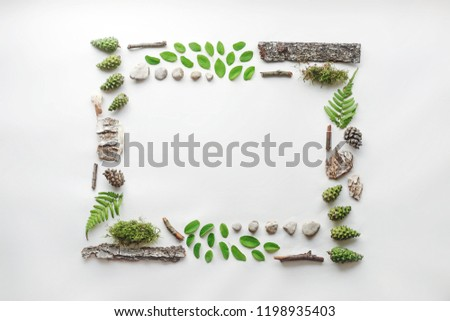 Square frame, Creative layout, natural layout of leaves, stones and wood. Empty for an advertising card or invitation. The concept of nature. Summer poster. Flat lay. Nature background #1198935403