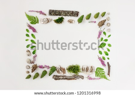 Square frame, Creative layout, natural layout of leaves, stones and wood. Empty for an advertising card or invitation. The concept of nature. Summer poster. Flat lay. Nature background #1201316998
