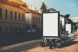 Square information board with road and crosswalk around, empty rectangular banner mock-up with bicycle parking behind, blank billboard with copy space place for advertising message or your logo