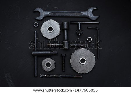 Square layout of different tools on dark background. Wrench tools, gear wheels, ring spanners, monkey wrenches, cogwheel, screws and bolts. Father's Day concept. Do it yourself. Flat lay #1479605855