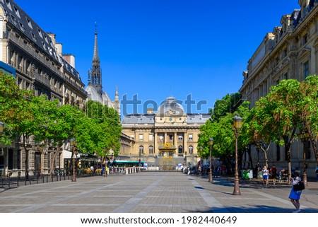Square Louis Lepine and Palais de Justice de Paris (Palace of Justice) in Paris, France.  Cozy cityscape of Paris. Architecture and landmarks of Paris.