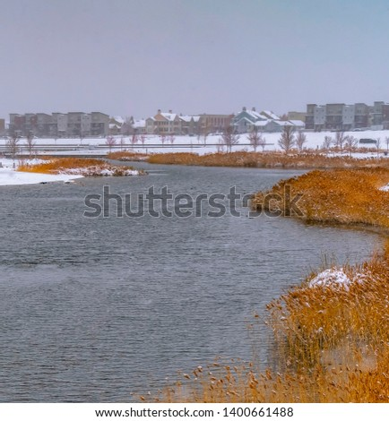 Square Oquirrh lake with view of snowy lakefront homes #1400661488