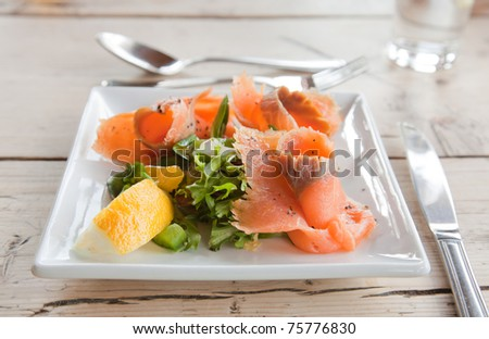 square plate of smoked salmon rosettes