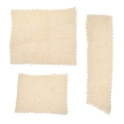 Square, rectangular long pieces of canvas, cut burlap fabric, patch for clothes, dry garbage, scraps of fabric, background for text from fabric isolated on a white background.