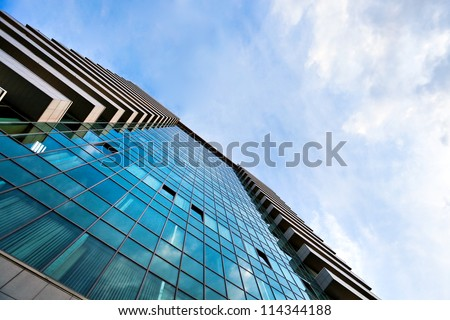 square side of pane in business center over blue bright sky #114344188