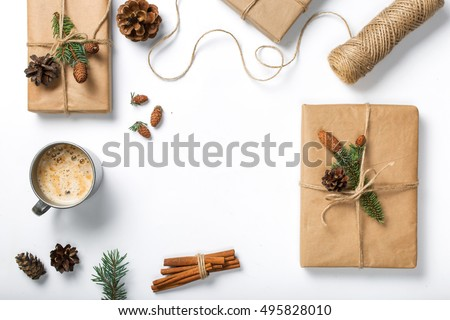 Square with decorations and gift handmade on white background, top view, flat lay
