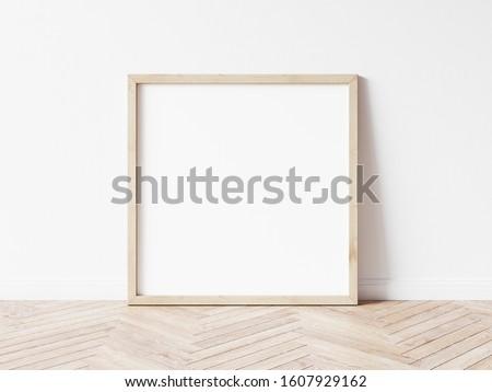 Square wood frame mockup. Wood frame on wood floor. 3d illustrations.