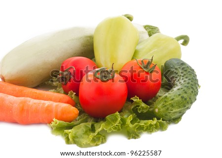 Squash, carrots, tomato, peppers and cucumber over white