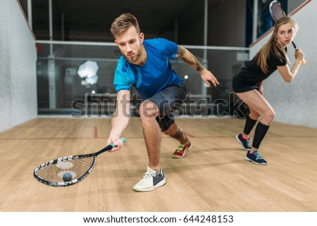 Squash game training, players with rackets Сток-фото ©