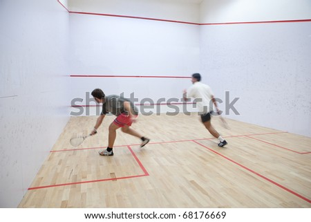 Squash players in action on a squash court (motion blurred image; color toned image) ストックフォト ©