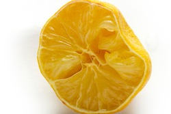Squeezed lemon on a white background