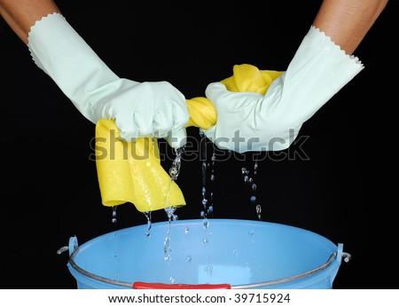 stock photo : Squeezing sponge, squeezing wet sponge.