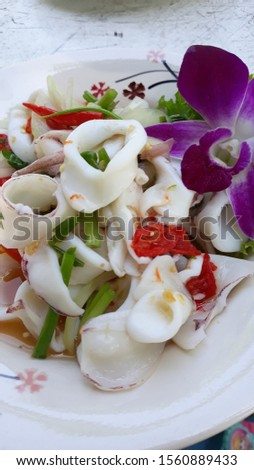 Squid salad with chilli and lemon, spicy and sour taste