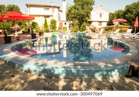 Sredets - June 7: Complex Bojura hunting lodge Strandja - pool, garden umbrella on June 7, 2015 Sredets, Bulgaria